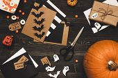 Halloween Pumpkin, Sweets, Halloween Cards And Decoration Made Of Craft Paper On The Wooden Table poster