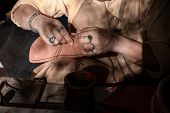 Shoe Master Sews Shoes And Leather. Shoe Master Engaged In Shoe Repair. poster