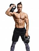 Bodybuilder Doing Exercise With Heavy Weight Kettlebells. Photo Of Muscular Man With Naked Torso And poster