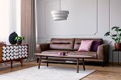 Real Photo Of Light Grey Sitting Room Interior With Window With Drapes, Leather Sofa With Pillows, C poster