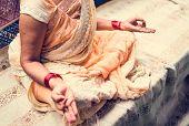 A meditating Indian woman poster