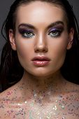 Beautiful Glamorous Girl Posing With Glitter On Body And Looking At Camera, Isolated On Grey poster