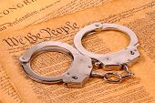 stock photo of preamble  - declaration of independence and handcuffs  - JPG
