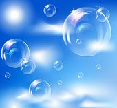 picture of soapy  - EPS10 vector realistic bubbles against blue sky background - JPG