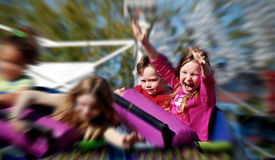 stock photo of amusement park rides  - Young Kids on Fast Rollercoaster - JPG