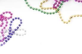 pic of mardi gras mask  - collection of colorful mardi gras beads - JPG