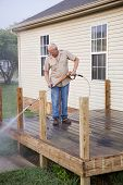 image of pressure-wash  - Contractor pressure washing deck getting home ready to sell - JPG