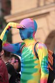 Brisbane, Qld Australia - August 11 : Unidentified Man Hiding Identity In Gay Rainbow Costume   Hold