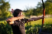 stock photo of longbow  - Young archer training with the  bow - JPG