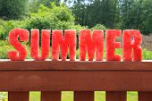 foto of greenery  - Summer spelled in letters cut out of watermelon - JPG