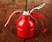 picture of hustle  - Red oil can - JPG