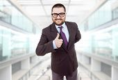 foto of feeling stupid  - young silly business man going thumb up - JPG
