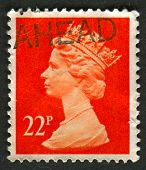 UK-CIRCA 1990:A stamp printed in UK shows image of Elizabeth II is the constitutional monarch of 16