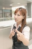 Asian business woman give you a gesture of fake, closeup portrait in outside of Taipei, Taiwan, Asia