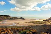 picture of landforms  - A view of Three Cliffs Bay on the Gower Peninsula in South Wales - JPG