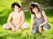 Portrait of two cute kids outdoor in a summer meadow