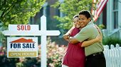picture of real-estate agent  - A young couple purchases a new home from a real estate agent - JPG