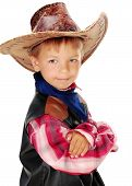 stock photo of buckaroo  - Boy dressed as a cowboy in a hat stands with his arms crossed - JPG