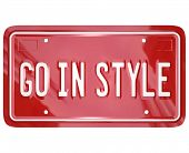 A red vanity license plate for a car or other vehicle with the words Go in Style to illustrate fashi