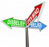 The words Disbelief, Belief and Open Mind on three way road or street signs to illustrate faith in a