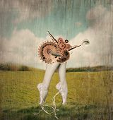 picture of surrealism  - Fantasy artistic image that represent feet tiptoe and calves of a classic ballerina in a ballet slippers with a surreal mechanism of gears that supposed to move them in a surreal background - JPG
