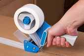 stock photo of dispenser  - Cardboard boxes stick dispenser for adhesive tape - JPG
