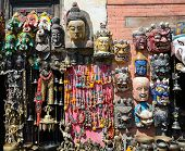 stock photo of nepali  - Face Nepali masks of Hindu gods on market in Kathmandu Nepal - JPG