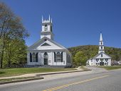 Two New England white wooden churches