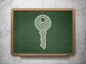 Privacy concept: Key on chalkboard background