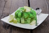 stock photo of jello  - Portion of Apple Jello with pieces of fresh fruit - JPG