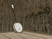 pic of banjo  - One banjo in a room of brown wood - JPG