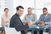 pic of half-dressed  - Portrait of an executive gesturing thumbs up with recruiters during a job interview at office - JPG
