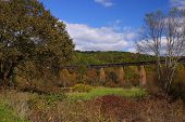 stock photo of trestle bridge  - A steel railroad bridge in the hills of West Virginia - JPG