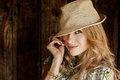 foto of flirty  - Portrait of Happy Blonde Woman with Hat - JPG