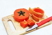 stock photo of excretory  - Sweet papaya on a chopping board isolated - JPG