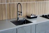 picture of sink  - a designer kitchen counter with sink and stove - JPG