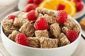stock photo of whole-wheat  - Healthy Whole Wheat Shredded Cereal with Fruit for Breakfast - JPG