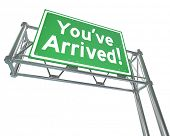 You've Arrived words on a green freeway road sign arriving your destination poster