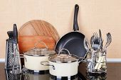 stock photo of saucepan  - Kitchen tools on table in kitchen - JPG