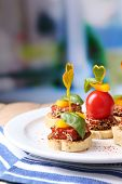 stock photo of canapes  - Tasty canapes with salami - JPG