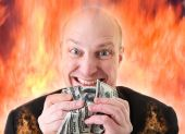 stock photo of greed  - Avarice businessman with money - JPG