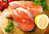 stock photo of salmon steak  - raw salmon steak on a wooden board