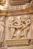pic of kandariya mahadeva temple  - Sculptures of loving couples illustrating the Kama Sutra on walls of Kandariya Mahadeva Temple at Khajuraho in India Asia - JPG