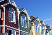 stock photo of duplex  - A row of colorful new townhouses or condominiums - JPG