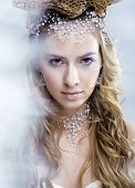 picture of snow queen  - beauty young snow queen in fairy flashes with crown on her head - JPG