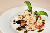 stock photo of octopus  - Risotto with prawns mussels octopus squids and deep - JPG