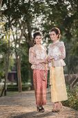 picture of polite girl  - Two beautiful girls getting dressed in Thai Traditional Costume - JPG