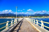 Постер, плакат: Pier Beach And Apuane Mountains In Forte Dei Marmi Versilia Tuscany Italy
