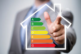 picture of footprint  - Businessman pointing to energy efficiency rating chart and house icon concept for performance - JPG