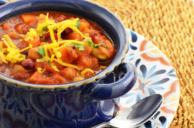 stock photo of sweet-corn  - Nutritious vegetarian chili full of tomato beans peppers sweet potato and corn - JPG